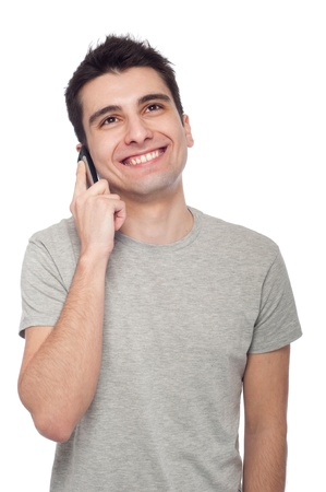 talking telephone: young casual man talking on the phone isolated on white background