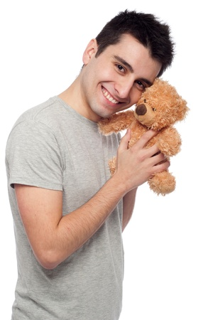 lovely portrait of a young man cuddling a teddy bear (isolated on white background) photo