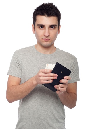 quiet young man showing his wallet with money (isolated on white background) Stock Photo - 8818367