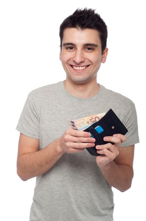 smiling young man showing his wallet with money and cards (isolated on white background)