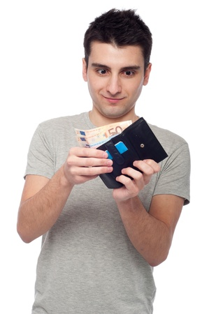 shocked young man looking at his wallet with money and cards (isolated on white background) Stock Photo - 8818362