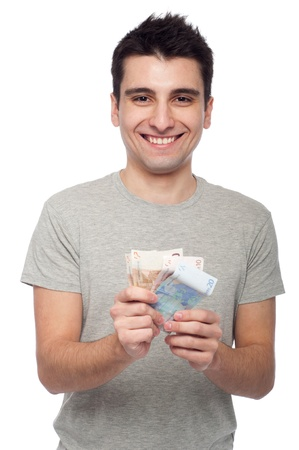 smiling young man showing his money, euro bills (isolated on white background) Stock Photo - 8818373