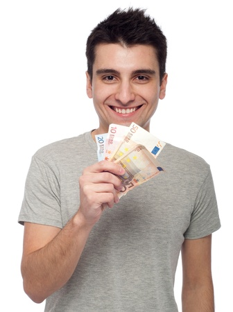 smiling young man showing his money, euro bills (isolated on white background)