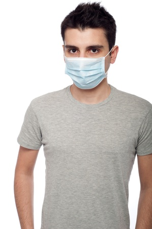 young man wearing a protective mask isolated on white background  photo