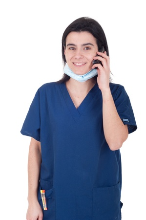 smiling female doctor in uniform talking on the phone (isolated on white background) photo