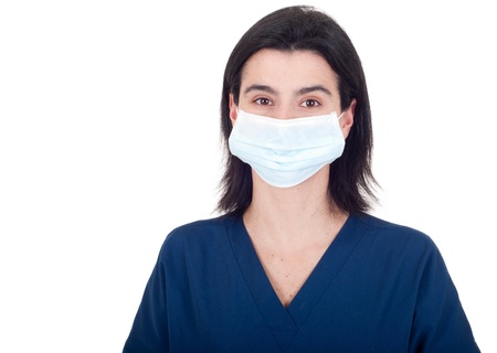 portrait of a young female doctor wearing mask isolated on white background photo