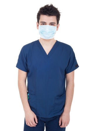 portrait of a young doctor wearing mask isolated on white background photo