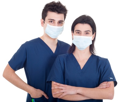 portrait of a team of doctors, man and woman wearing mask and uniform isolated on white background photo