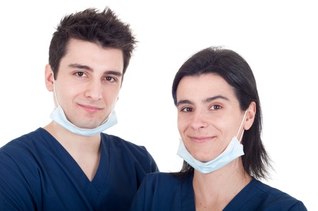 closeup portrait of a team of doctors, man and woman wearing mask and uniform isolated on white background photo
