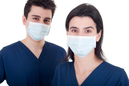 portrait of a team of doctors, man and woman wearing mask and uniform isolated on white background (focus on woman) photo