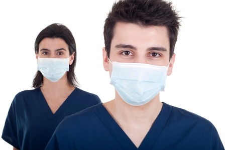 portrait of a team of doctors, man and woman wearing mask and uniform isolated on white background (focus on man) photo