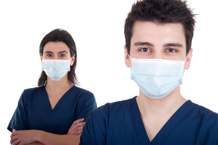 portrait of a team of doctors, man and woman wearing mask and uniform isolated on white background (focus on man) Stock Photo - 9137877