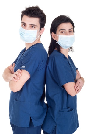 back to back portrait of a team of doctors wearing mask and uniform isolated on white background photo