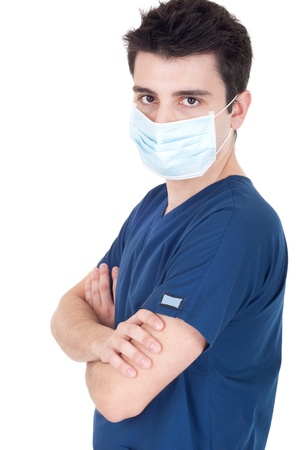 confident young male doctor wearing mask isolated on white background (folded arms) photo