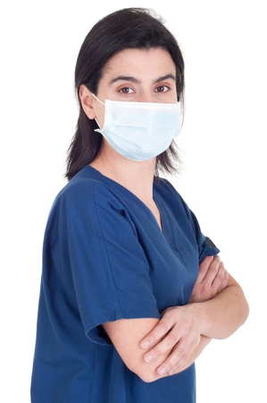 confident young female doctor wearing mask isolated on white background (folded arms) photo
