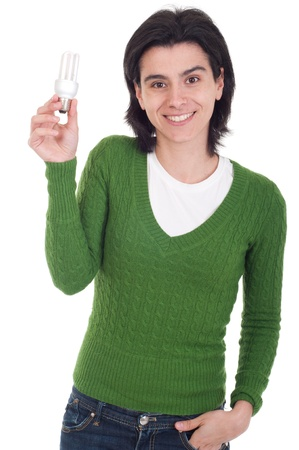 smiling casual woman holding a energy-saving lightbulb isolated on white background photo
