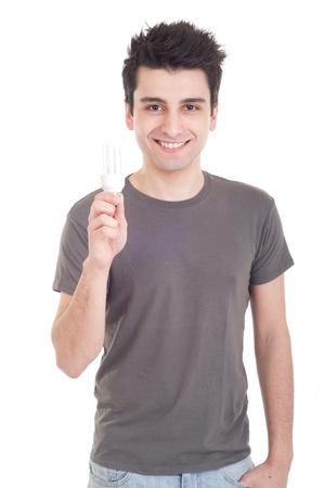 smiling casual man holding a energy-saving lightbulb isolated on white background Stock Photo - 9296991