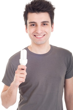 t bulb: smiling casual man holding a energy-saving lightbulb isolated on white background