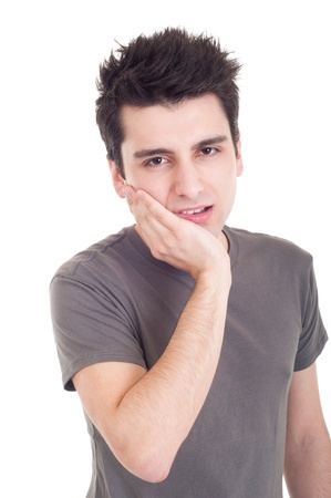 young casual man having a toothache isolated on white background photo