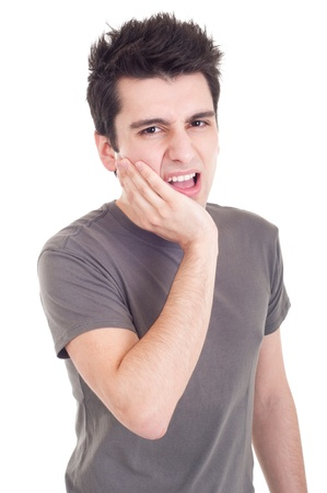 young casual man having a toothache isolated on white background