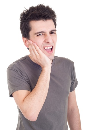 toothache: young casual man having a toothache isolated on white background