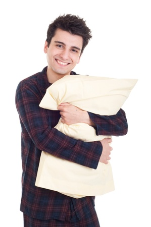 pjs: smiling young man in pajamas holding pillow isolated on white background