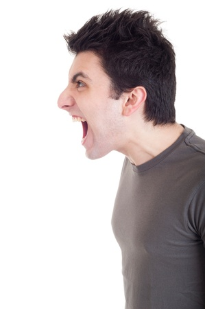 agressive: profile view of a very angry man screaming isolated on white background Stock Photo