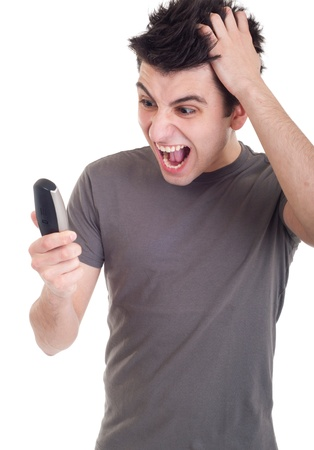 angry young man yelling at mobile phone isolated on white background photo