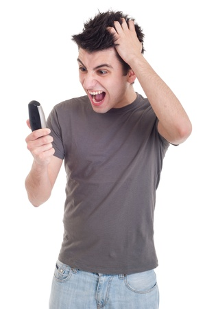 angry young man yelling at mobile phone isolated on white background Stock Photo - 9304639