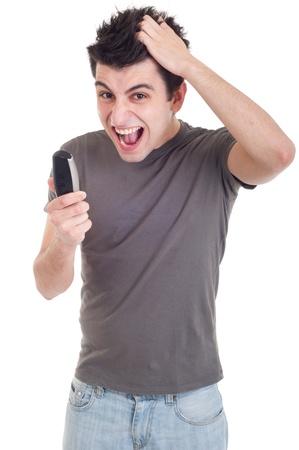 molesto: angry young man gritando en tel�fono m�vil aislada sobre fondo blanco