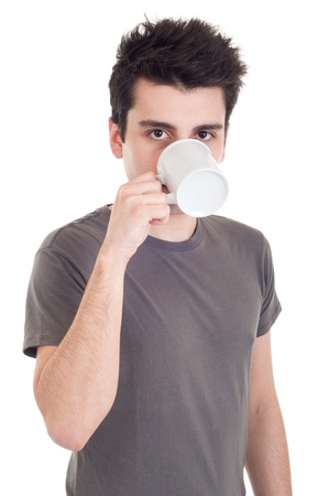 handsome casual man drinking coffeetea mug (isolated on white background) photo