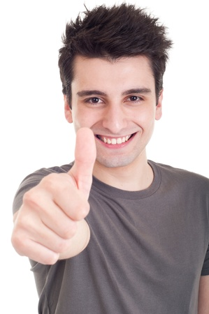 successful student: smiling young man with thumbs up on an isolated white background