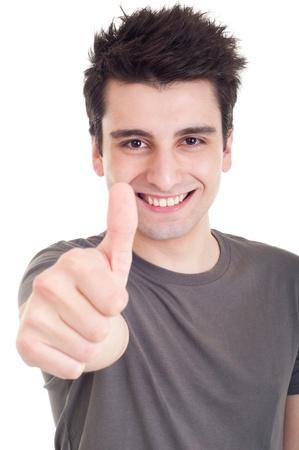 facial gestures: sonriente a joven con pulgares arriba sobre un fondo blanco aislado