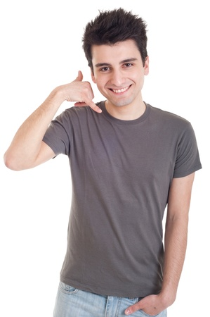 gestures: smiling casual man showing call me gesture isolated on white background