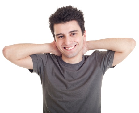 hands behind head: smiling casual man relaxing with hands behind back isolated on white