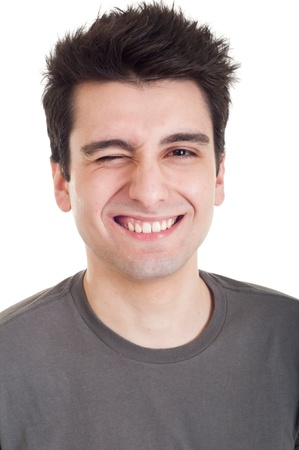 cheerful young man winking and smiling isolated on white background Stock Photo - 9380367