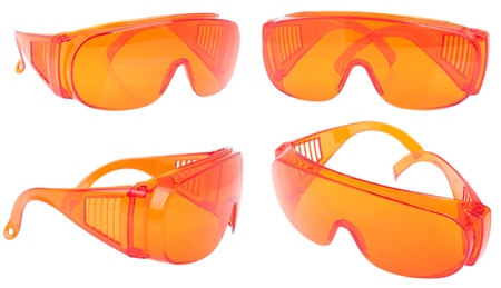 collection of orange safety glasses for patientother (health equipment to prevent cross infection) isolated on white photo