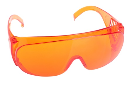 protective glasses: orange safety glasses for patientother (health equipment to prevent cross infection) isolated on white
