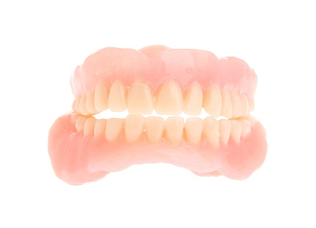surrogate: full set of a acrylic denture isolated on white background
