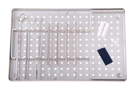 articulation: dentistry kit in a metal tray (surgery instruments, articulation paper, cotton rolls and wools)