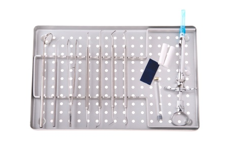 articulation: dentistry kit in a metal tray (surgery instruments, articulation paper, cotton rollswools, cartridge and syringe) Stock Photo