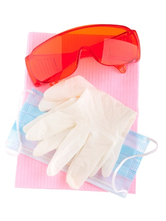protective wear: health and safety equipment (glasses, gloves, mask and bib) to prevent cross infection (isolated on white) Stock Photo