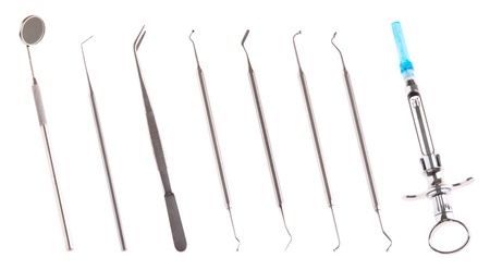 dentists surgery: set of stainless steel dental surgery instruments for teeth care (isolated on white background) Stock Photo