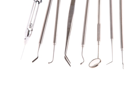 periodontics: stainless steel dental surgery instruments for teeth care (isolated on white background)