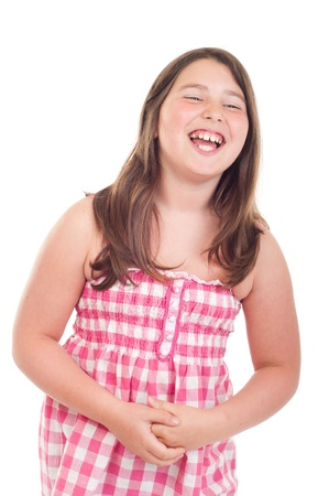 joyful little girl laughing in a pink top (isolated on white background) photo