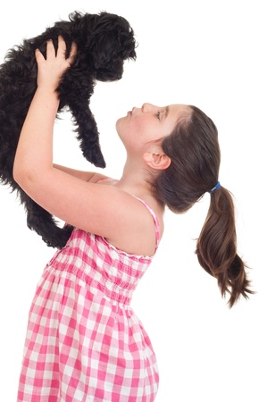 adorable little girl kissing her dog (isolated on white background) photo