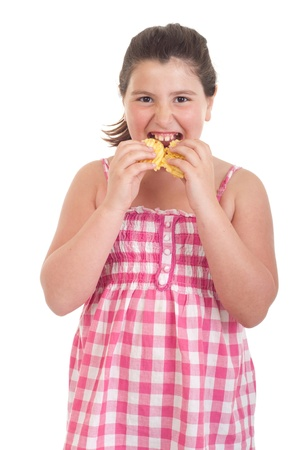 obese girl: cute little girl with hungry expression eating chips (isolated on white background)