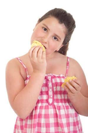 obese child: cute little girl eating chips (isolated on white background)
