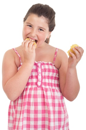 cute little girl with hungry expression eating chips (isolated on white background) photo