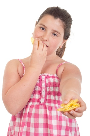 overweight kid: cute little girl eating chips and offering some too (isolated on white background)